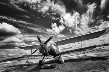 Fototapeta Samoloty Old airplane on field in black and white