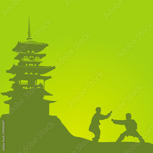 Two men are engaged in a kung fu against the monastery. - 90414697