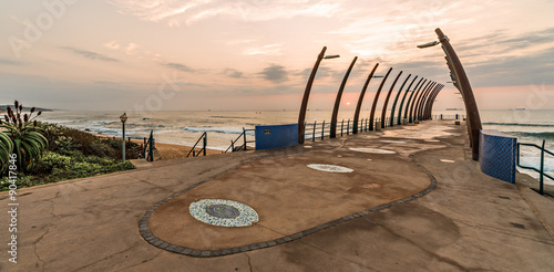 Poster Afrique du Sud View of ships on Indian Ocean through the Millenium Pier in Umhlanga Rocks at sunrise