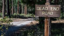 Dead End Road Sign On Rural Gr...