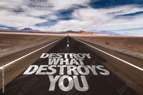 Photo Destroy What Destroys You written on desert road
