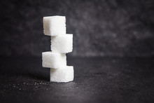 Cloose Up White Sugar Cubes On Black Stone Plate Background