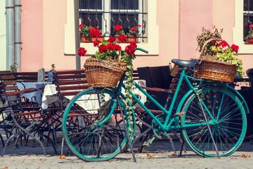 Fototapeta na wymiar Old rusty bicycle with flowers