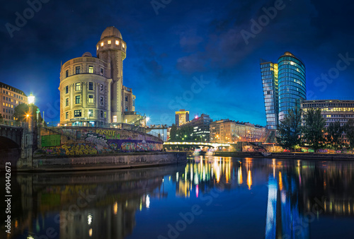 The Danube Canal in Vienna at Night with Urania and Uniqa Tower, Vienna, Austria