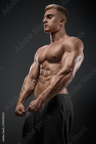 Strong and power bodybuilder posing Poster