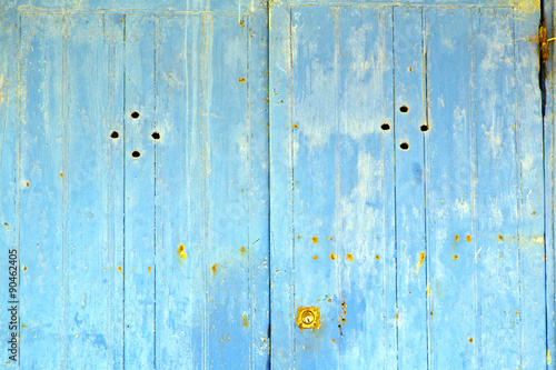Stripped Paint In The Blue Wood Door Rusty Nail