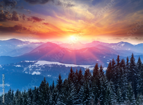 Poster  sunset in winter mountains
