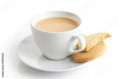 Fotobehang Koekjes White ceramic cup and saucer with tea and shortbread biscuits. I