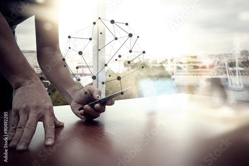 Fotografia  designer hand working and smart phone and laptop on wooden desk
