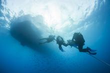 Divers Decompressing Underwate...