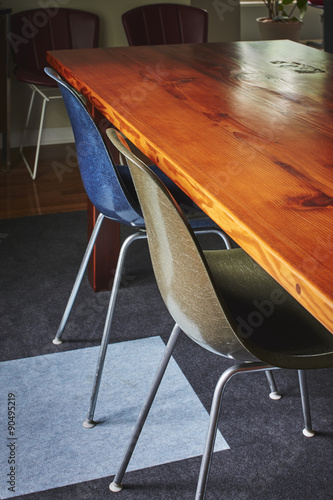 mid century modern chairs in a dining room Poster
