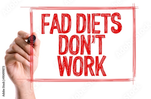 Fotografija  Hand with marker writing the word Fad Diets Don't Work