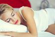 young sleeping woman at bedroom
