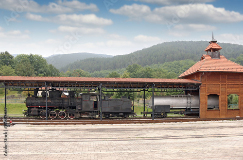 old steam locomotive on railway station