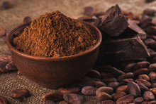 Cocoa Powder In A Brown Ceramic Bowl, Raw Cocoa Beans In The Pee