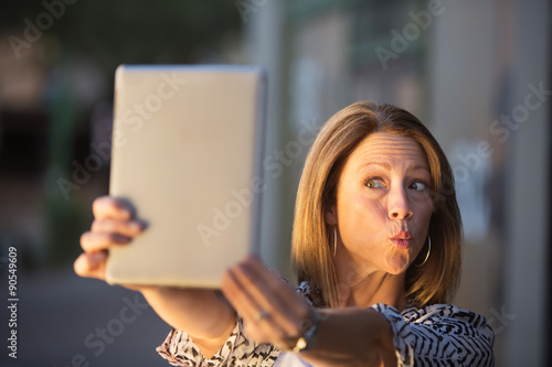 Fotografie, Obraz  Lady Posing For Tablet