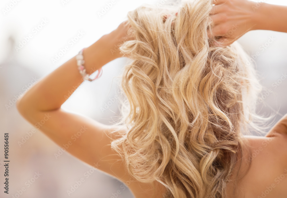 Fototapeta Blonde woman holding her hands in hair