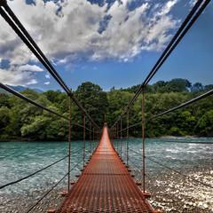 Fototapeta Optyczne powiększenie Landscape view of Long Steel Suspension bridge above the river