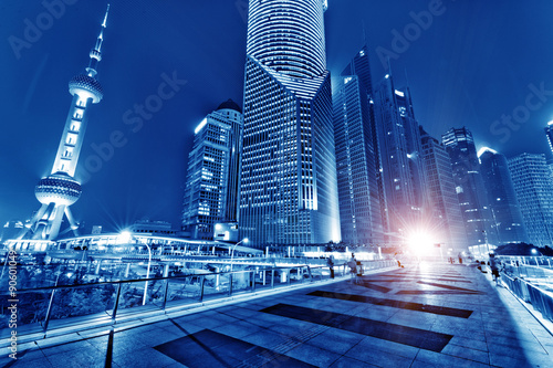 the light trails on the modern building background in shanghai china Poster