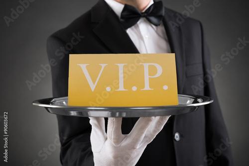 Fotografía  Waiter Showing Vip Text On Banner