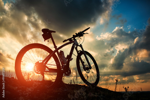 Fotobehang Fiets Beautiful scene of bike on sunset