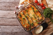 Greek Moussaka In Baking Dish With The Ingredients. Horizontal Top View