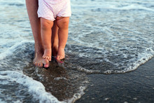 Mother And Baby Feet At The Sea Foam