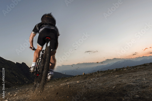 Fotografie, Obraz  mountainbiker on the limit to keep his mountain trail