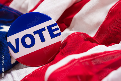 "Fotografie, Obraz  ""VOTE"" button or pin on an American flag"