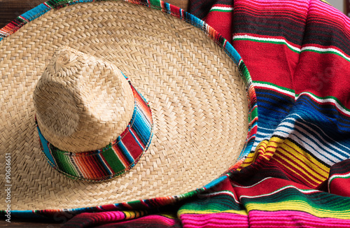 фотографія  Mexican Sobrero and Serape blanket on yellow background with cop