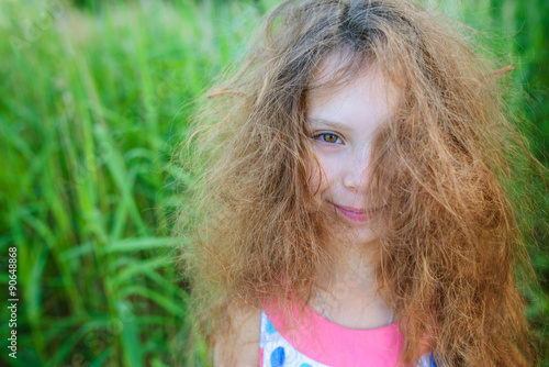 Fotografie, Obraz  Little beautiful girl with curly hair
