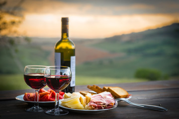 Fototapeta Do gastronomi still life Red wine ,cheese and prosciutto