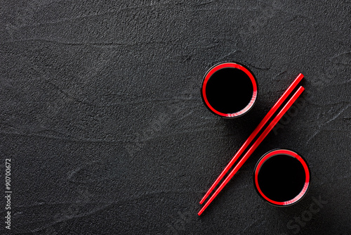 Chopsticks and bowl with soy sauce, discount concept Canvas