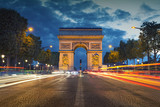Fototapeta Fototapety Paryż - Arc de Triomphe. Image of the iconic Arc de Triomphe in Paris city during twilight blue hour.