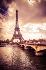 Fototapeta Mosty Beautiful Eiffel Tower in Paris France under golden light