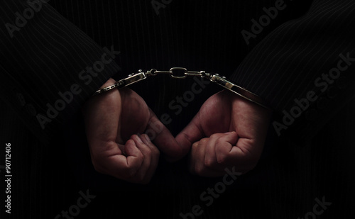 Leinwand Poster hands in handcuffs