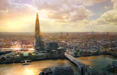 LONDON, UK - JANUARY 27, 2015: Shard of glass City of London, business and banking aria. London's panorama in sun set. View from the St. Paul cathedral