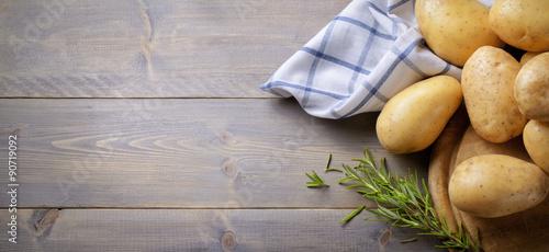 Fotografie, Obraz  Potatoes and rosemary