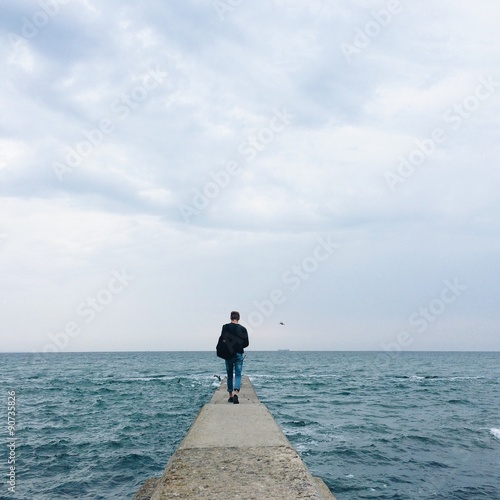 lonely man on the sea pier