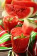 Glasses of watermelon juice on striped napkin, closeup