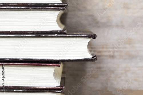 Valokuva  books on wooden planks background, top view
