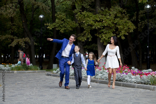 Spoed Fotobehang Japan Happy Family Walking Along Suburban Street