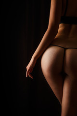 Obraz na SzkleSexy butt girls in underwear over black background