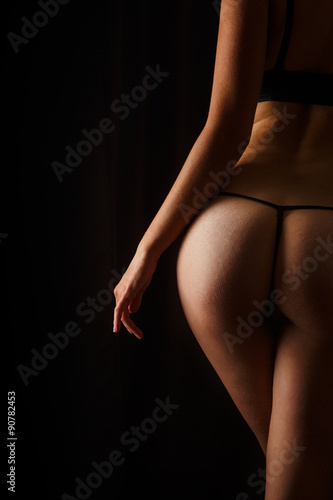 Fotografia  Sexy butt girls in underwear over black background