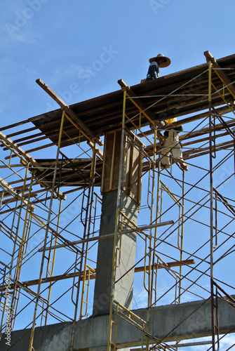 Group of construction worker fabricating beam formwork - Buy this