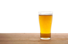 Glass Of Beer On Wooden Bar Isolated