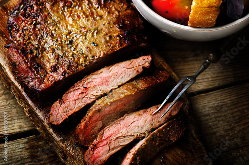 Photo  flank steak  with tomato salad.