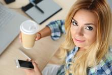 Female Designer In Office Drinking Morning Tea