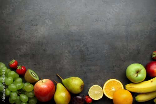 Foto op Plexiglas Vruchten Fresh fruits on grey kitchen table