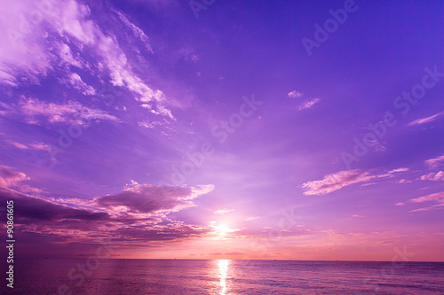 Tropical beach with sunset sky and sea wave